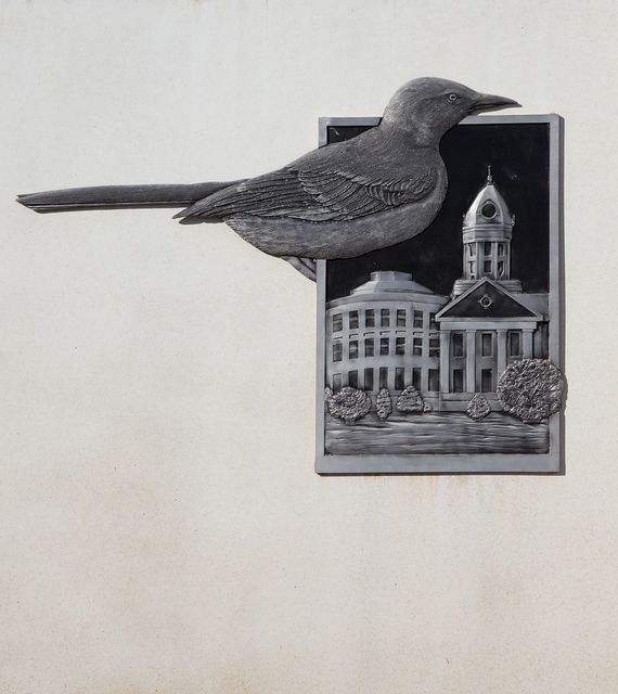 """Industrial site logo in Monroeville, Alabama, showing the bird and the old Monroe County Courthouse used in the play """"To Kill a Mockingbird"""" by resident Harper Lee"""