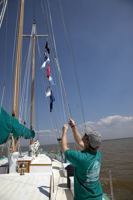 Joshua is a classic 72' wooden schooner sailing on Mobile Bay, Alabama, under the command of Captain Carol Bramblett. Evan Austin folds up the sails after coming into the port