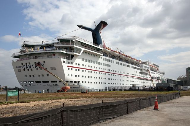 Large cruise ship picks up passengers at a loading dock a block away from downtown Mobile, Alabama