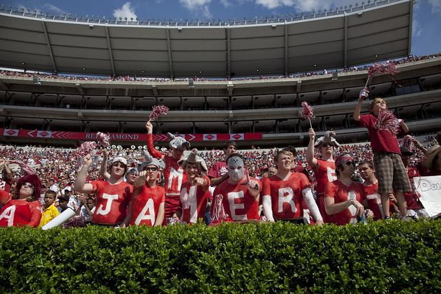Most of the fans wear crimson and white with the name of the football team on their garments at University of Alabama, Tuscaloosa, Alabama