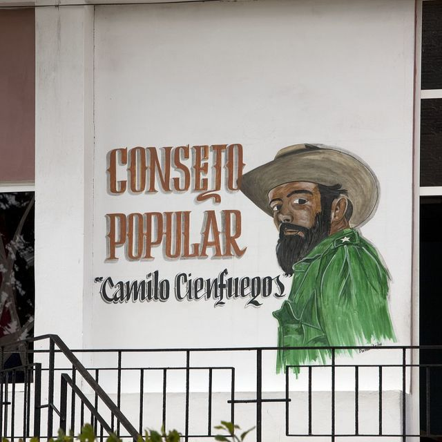 One of the Cuban revolutionary leaders Camilo Cienfuegos depicted in a hand painted sign on an apartment building in Havana, Cuba