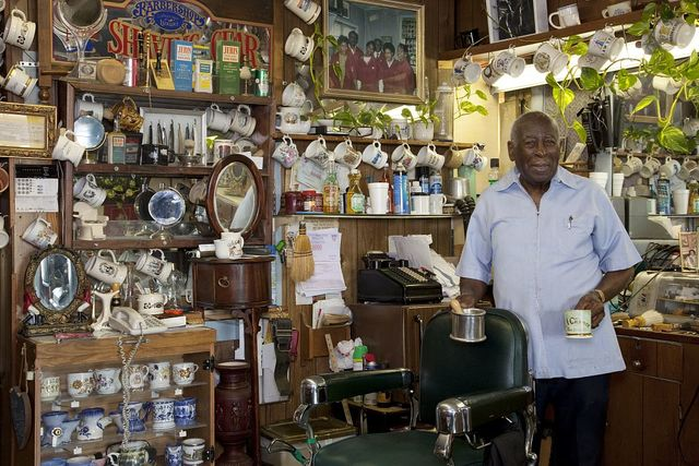 Rev. Thomas Linton has a shaving cup collection that fills his entire barber shop. He was also famous for his work in the Civil Rights Movement in Tuscaloosa, Alabama