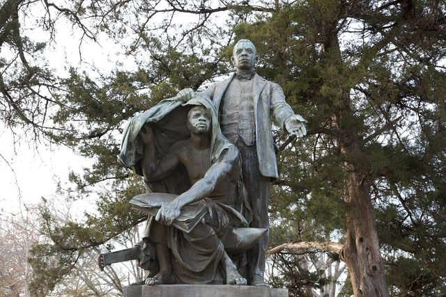 "Statue of Booker T. Washington ""Lifting the Veil of Ignorance,"" by Charles Keck located at Tuskegee University in Tuskegee, Alabama"