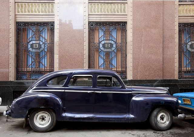 Vintage car parked next to the Barcardi Rum building in Havana, Cuba