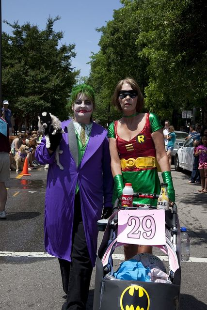 Wanda Newman and Teresa Phillips and their dog Cammi pose in Batman outfits for Do Dah Day, Birmingham, Alabama