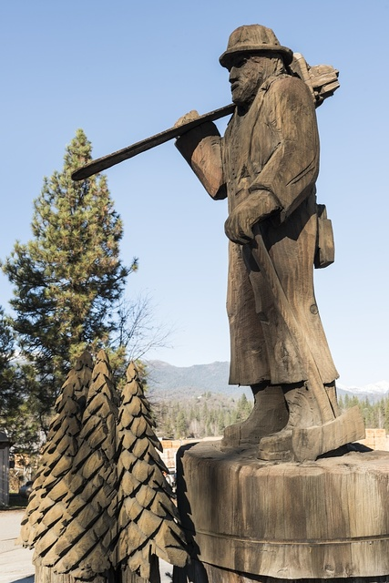 A carving of a minor in front of the Trinity Inn in Weaverville, a popular tourist destination in the Whiskeytown-Shasta National Recreation Area, northwest of Redding, California