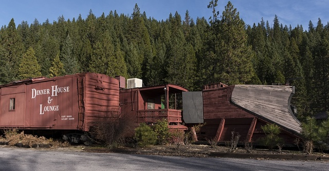 A vintage locomotive plow at Rail Road Park, an unusual motel and resort complex in which guests may opt to stay and sleep in a caboose or other restored, antique railroad car. Dunsmuir, California