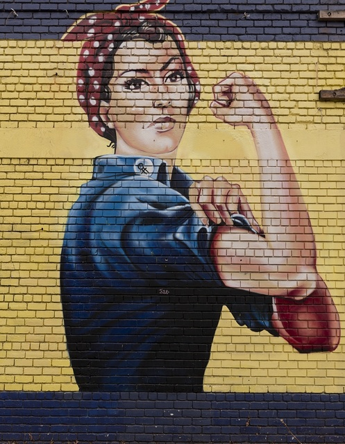 Close-up of Rosie the Riveter mural on an abandoned building in Sacramento, California