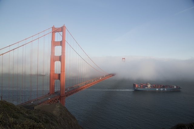 Fog rolls across the Golden Gate Bridge, San Francisco, California