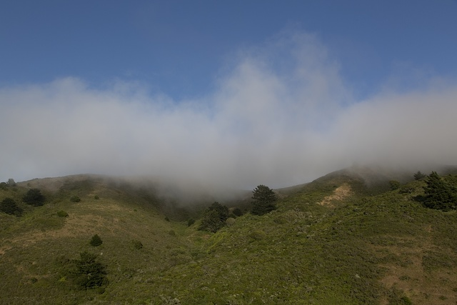 Fog rolls across the hills near the Golden Gate Bridge, San Francisco, California
