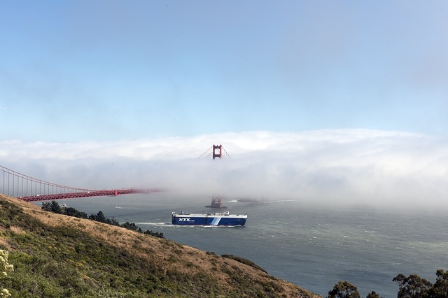 Golden Gate Bridge with fog rolling over it. San Francisco, California