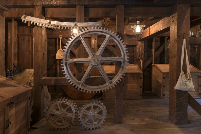 Interior tools and milling equipment at the Bale Grist Mill, now a California Historic Park, operated by the Napa County Regional Park and Open Space District on California Highway 29 between St. Helena and Calistoga, California