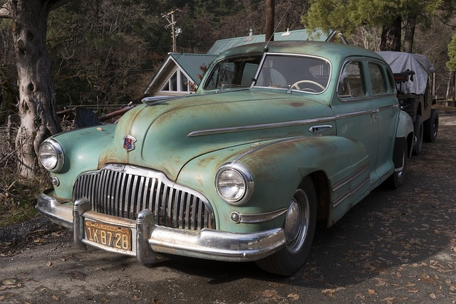 Judging from its license plate, and its general condition this once-fashionable Chrysler hasn't hit the road since 1942, though its tires look good as new