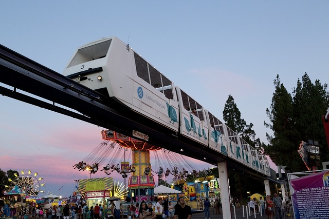 Monorail and rides at dusk at the 2012 California State Fair held in Sacramento, California