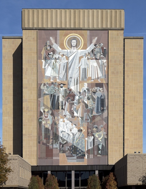 """Mosaic of Christ on the side of the Hesburgh Library entitled """"The Word of Life,"""" but often referred to as Touchdown Jesus at the University of Notre Dame, a Catholic research university located in Notre Dame, an unincorporated community north of the city of South Bend, in St. Joseph County, Indiana"""