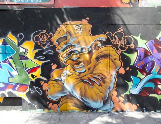 Mural on sculptural mural building on the corner of 6th St. and Howard St. in San Francisco, California