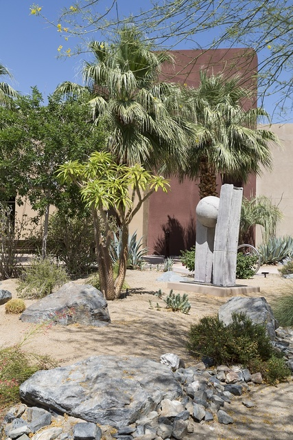 Palm trees and sculpture in the Southern California desert