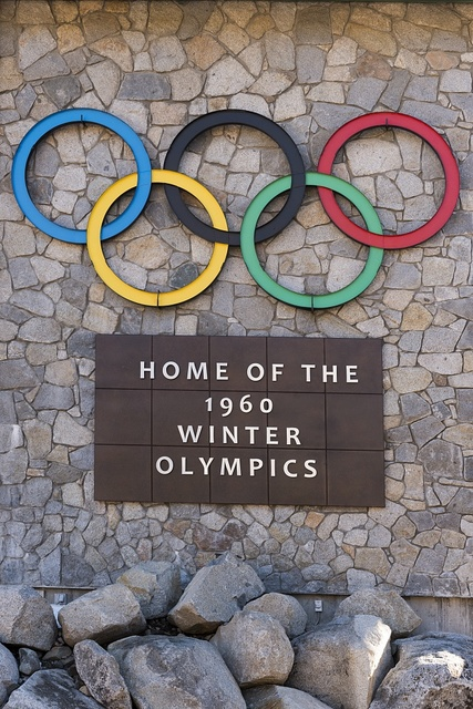 """Sign """"Home of the 1960 Winter Olympics"""" at the Village at Squaw Valley, a year-round Sierra Mountain resort in Olympic Valley, west of Tahoe City, California"""