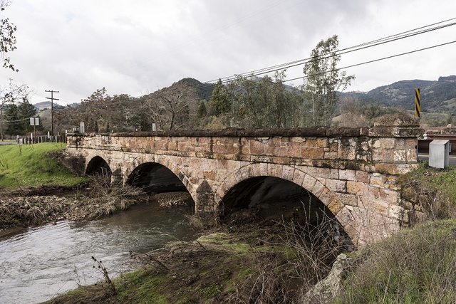 The Garnett Creek Bridge on Highway 29 near Calistoga, California, is one of what was once more than 300 stone-arch bridges in the Napa Valley