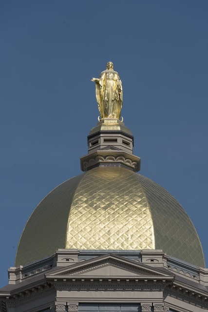 The Main Building's gold dome topped by a golden statue of St. Mary at the University of Notre Dame, a Catholic research university located in Notre Dame, an unincorporated community north of the city of South Bend, in St. Joseph County, Indiana
