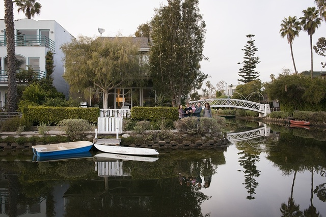 Members of two families, left to right: John and Nancy Kenyon, with son, Sammy; and Alix and Jon Mozenter, with daughter, Emma, enjoy the famous canals of the Venice neighborhood on the west side of Los Angeles, California