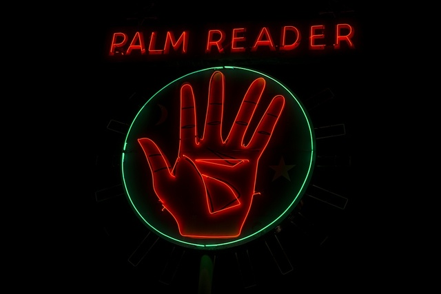 """Neon sign advertising the services of """"Madam Sophia,"""" a palm reader in the town of Fowler, south of Fresno, California"""
