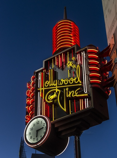 Neon sign at, and advertising, the famous corner of Hollywood Boulevard and Vine Street in the Hollywood neighborhood of Los Angeles, California