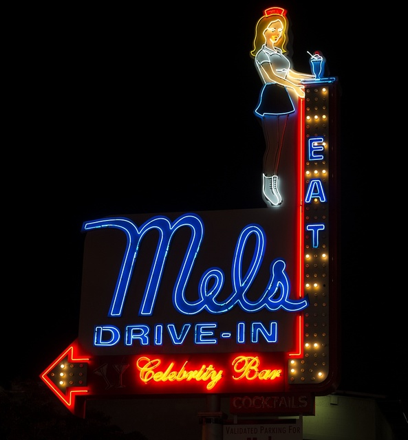 "Neon sign for Mel's Drive-In and ""celebrity bar"" in the Hollywood section of Los Angeles, California"