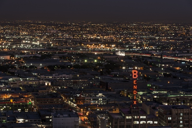"Nighttime skyline view of Los Angeles, California, centering on the city's famous ""Bendix sign"""