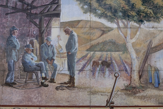 """Portion of the mural """"Domingos Blacksmith Shop,"""" painted in Lompoc, California, in 1995 by artist Suzanne Cerney of Santa Barbara, California"""