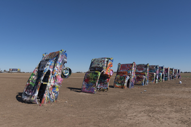 """Robert Griffin is no spray-painting vandal. Like thousands of other visitors to the """"Cadillac Ranch"""" along Old U.S. Route 66 outside Amarillo, Texas, he is encouraged to bring a along a spray can to add a touch or two to the unusual public art installation. Thus the overall look remains the same over time, but the details change daily"""