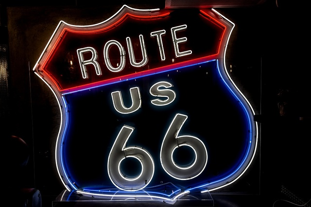 Route 66 neon sign, part of a display of vintage and neon from historic U.S. Route 66 on the median strip of Santa Monica Boulevard in West Hollywood, California