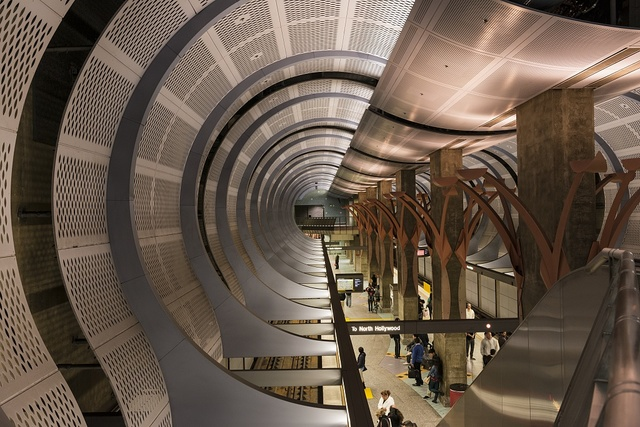 """Sweeping artwork called """"Underground Girl,"""" by Sheila Klein and Dworsky Associates Architects, forms a canopy for riders above the underground platform of the Hollywood-Highland station on Los Angeles's Metro subway line"""