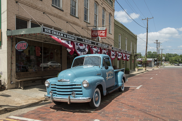 A 1950s-vintage truck outside a general store in Jefferson, a town in Marion County in East Texas on whose main street almost every commercial building, and many nearby homes, have a historic marker