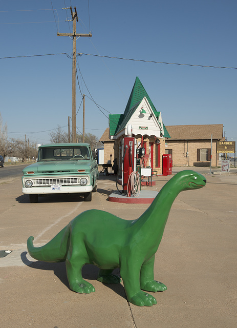 A carefully restored old Sinclair gasoline station, complete with the company's signature dinosaur, in Snyder, the seat of Scurry County, Texas