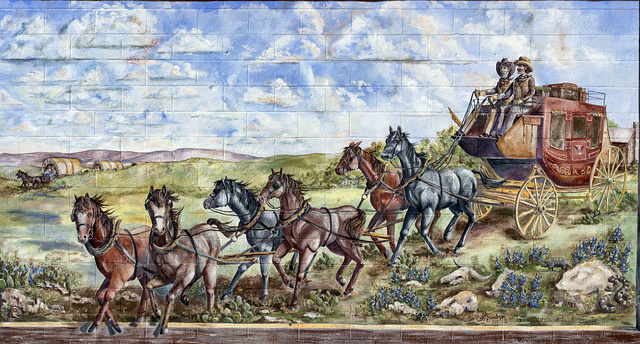 A downtown mural, by artist Crystal Goodman, in San Angelo, the seat of Tom Green County, Texas. It depicts an early stagecoach of the type that brought pioneers to the city in the 1840s