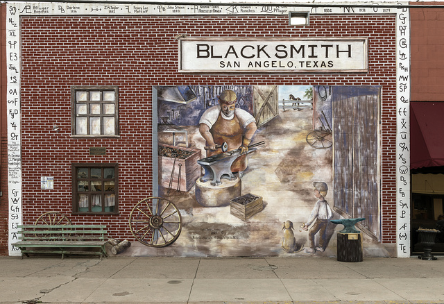A downtown mural depicting blacksmithing, an important Old West business, in San Angelo, the seat of Tom Green County, Texas