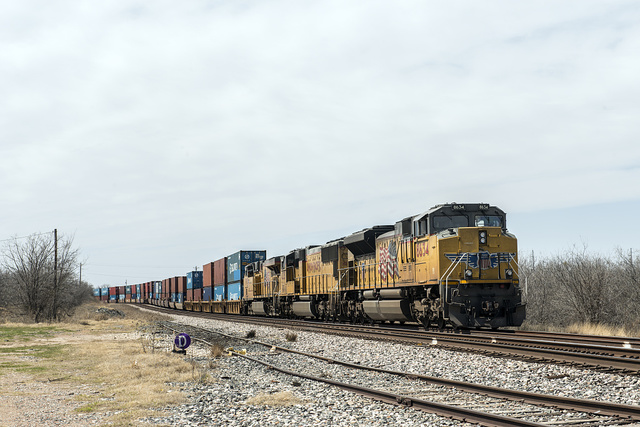 A long Union Pacific freight train approaches near Cisco in Eastland County, Texas