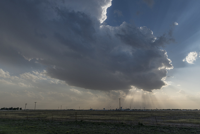 A massive cloud presages a thunderstorm above Groom, a tiny community along old U.S. Route 66 in the Texas panhandle