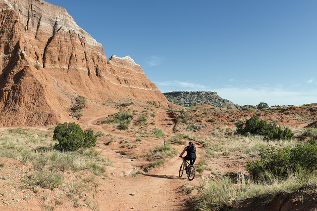 A mountain biker tests a rugged path amid the rock formations in Palo Duro Canyon State Park in the Texas panhandle