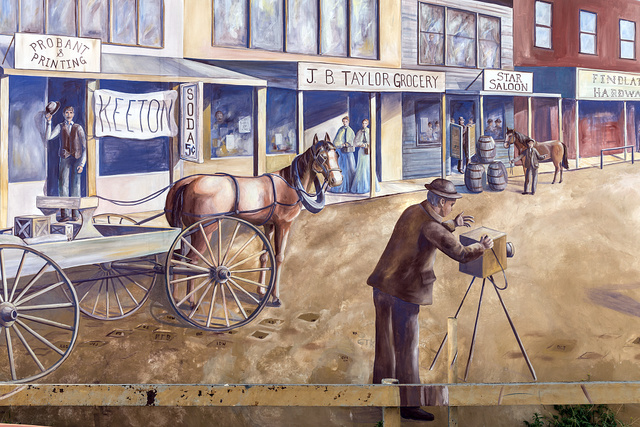 A mural, completed in 2005, depicting photographer M.C. Ragsdale, shooting a scene along the 200 block of South Chadbourne Street in San Angelo, the seat of Tom Green County, Texas