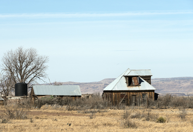 A pitched-metal-roof structure, common in rural West Texas, north of Alpine