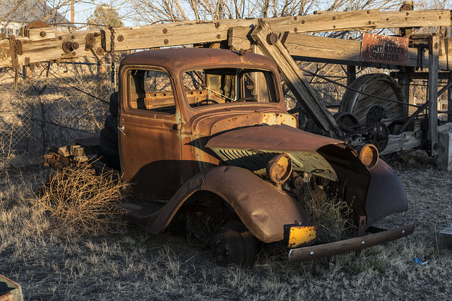 """A rusted old truck and remnants of a """"Fort Worth Spudder"""" in Marfa, Texas"""