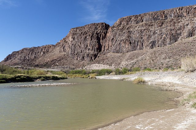 A view of the Rio Grande River, looking generally west, in Big Bend Ranch State Park, Brewster County, Texas. The United States to the right, a sliver of Mexico on the left