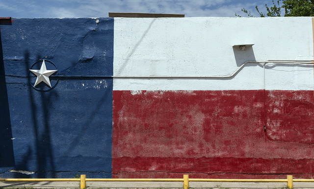 A wall colorfully painted with the likeness of the Texas flag, complete with a 3-D star, in the little town of Asherton in Dimmit County, Texas