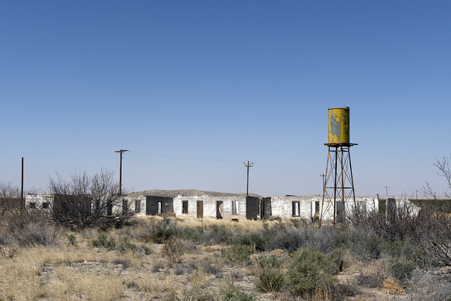 Abandoned buildings and water tower in what is now a ghost town named Salt Flat along the road carrying U.S. Highways 62-180 near the New Mexico border in Hudspeth County, Texas