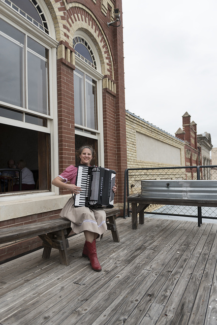 Accordionist Valina Polka practices on a balcony at Sengelmann's Restaurant, outside the annual Texas Polka Festival in Schulenburg, Texas