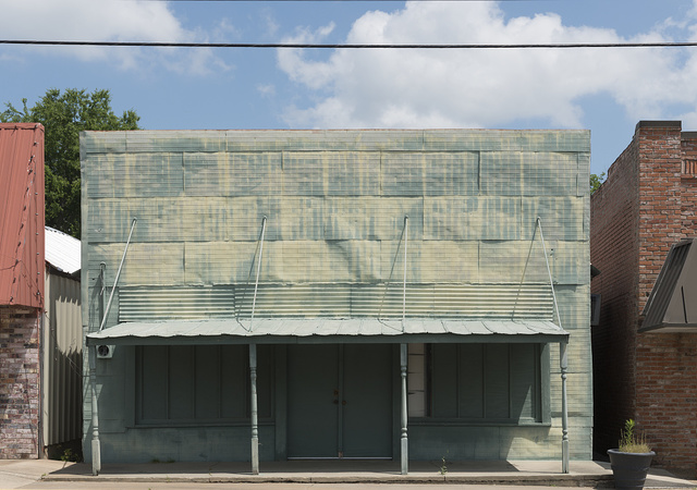 An abandoned building clad in painted sheets of tin in Emory, the seat of Rains County in East Texas