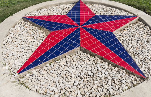 "An artistic, raised approximation of the Texas lone star at a Texas ""welcome center"" near the intersection of Interstate Highway 35 and U.S. 83 in Laredo, Texas"