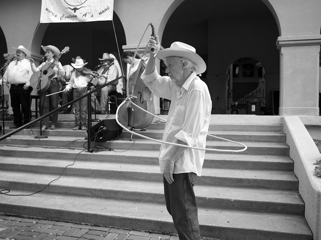An old feller gives a lariat lesson at the Cowtown Opry in the Stockyards District of Fort Worth, Texas